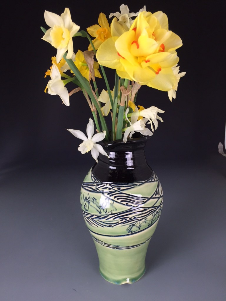 green vase + daffodils